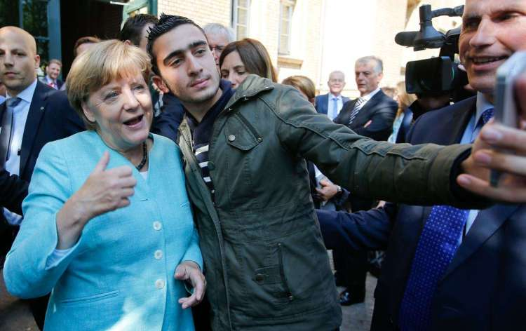 Merkel smiles for dominant immigrant