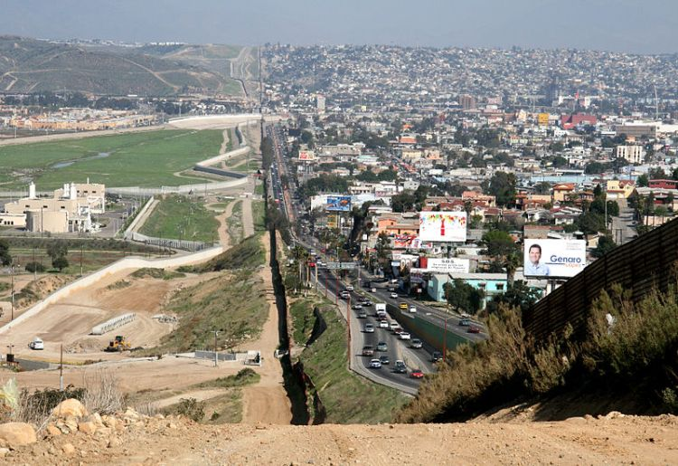 A small fence separates densely-populated Tijuana, Mexico, right, from the United States in the Border Patrol's San Diego Sector.