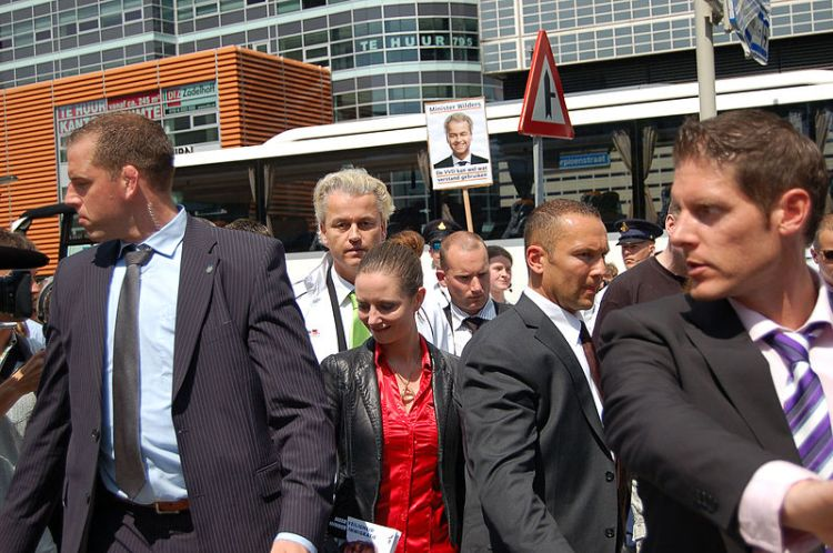Geert Wilders at a political rally surrounded by body guards
